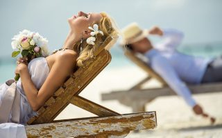 Honeymoon-time-couple-relax-mood-at-beach